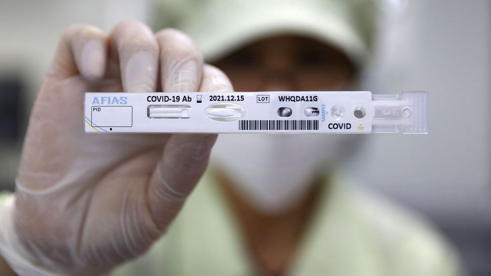 An employee holds up a Covid-19 testing kit in Chuncheon, South Korea (Credit: Getty Images)
