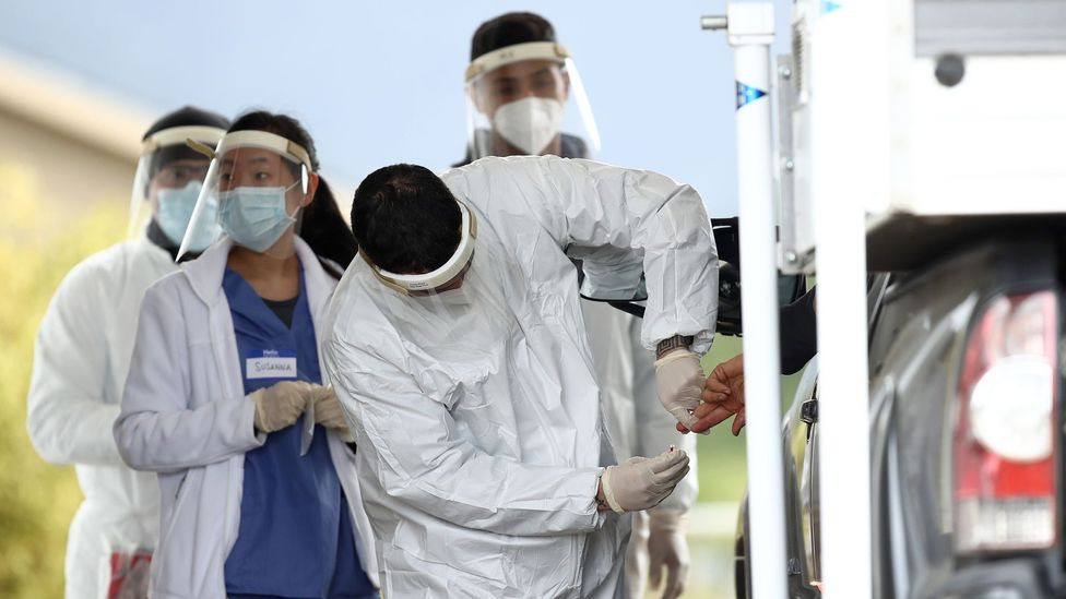 A medical professional administers a Covid-19 test in Bolinas, California on 20 April 2020; the town is attempting to test each of its 1,600 residents (Credit: Getty Images)