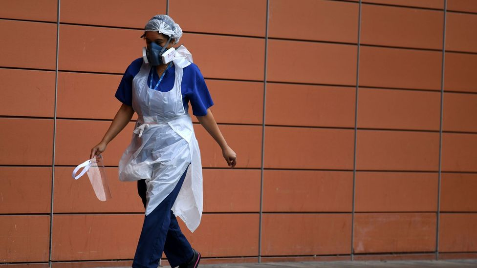 A nurse walks outside The Royal London Hospital on 18 April 2020