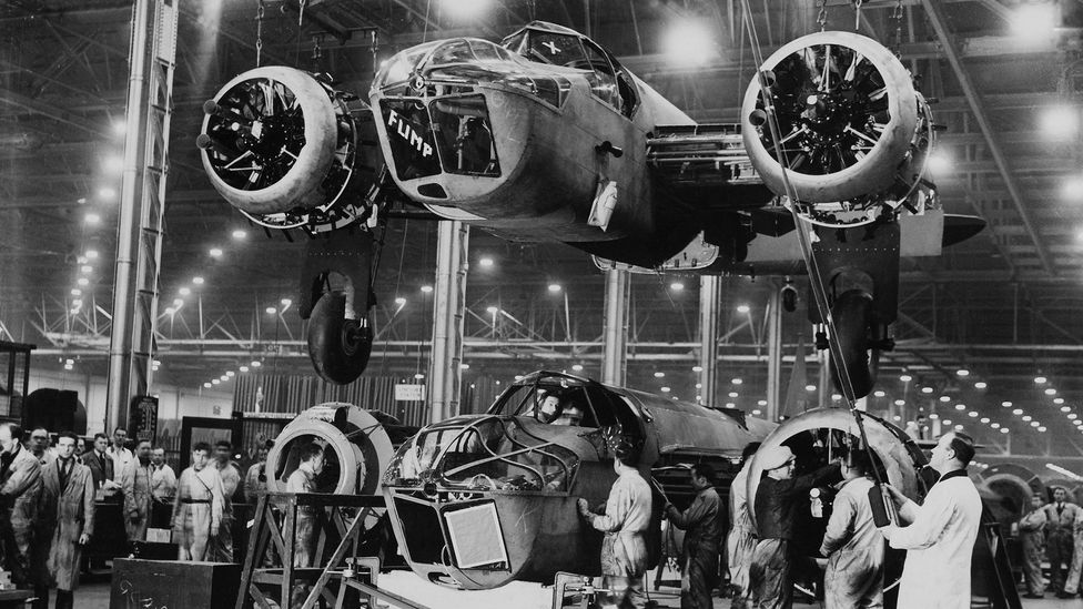 During World War Two, factories which had once made cars were quickly reorganised to make weapons such as these British bombers (Credit: Getty Images)