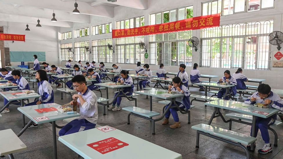Students have lunch while keeping distance at a school on the first day of its reopening in Guangzhou, China (Getty Images)