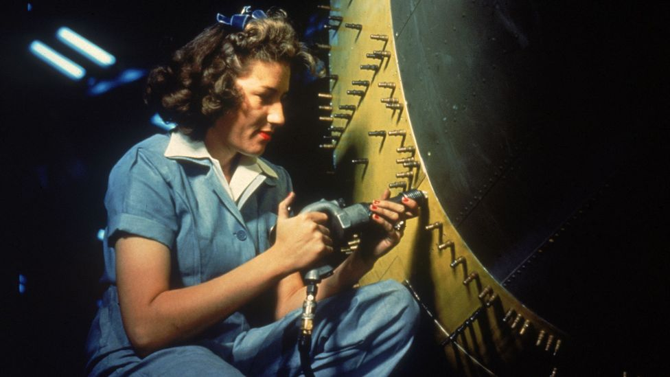 Woman rivetting aircraft (Credit: Getty Images)