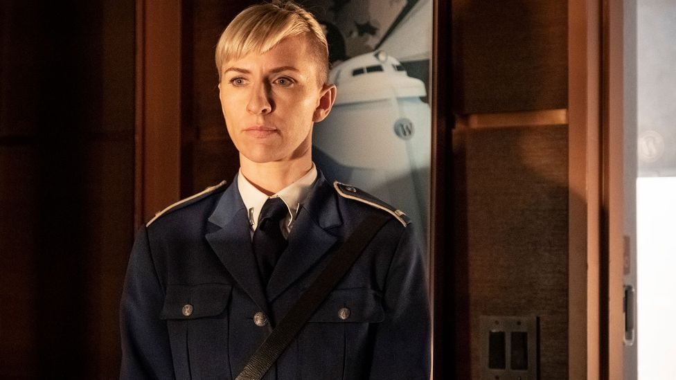 Mickey Sumner plays Bess Till, a security officer called investigating the central murder