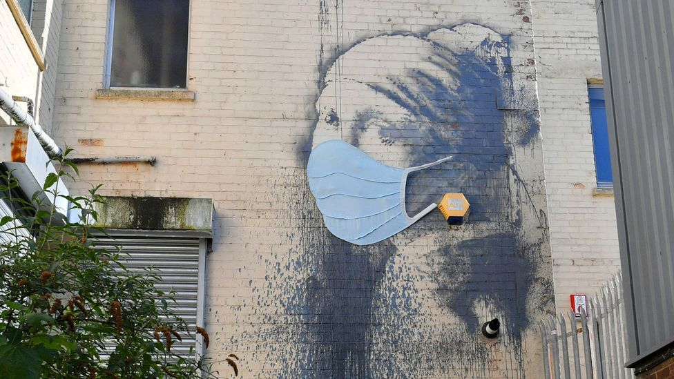 A parody of Girl with a Pearl Earring by Johannes Vermeer, Banksy's Girl with a Pierced Eardrum has recently been updated with a mask (Credit: PA)