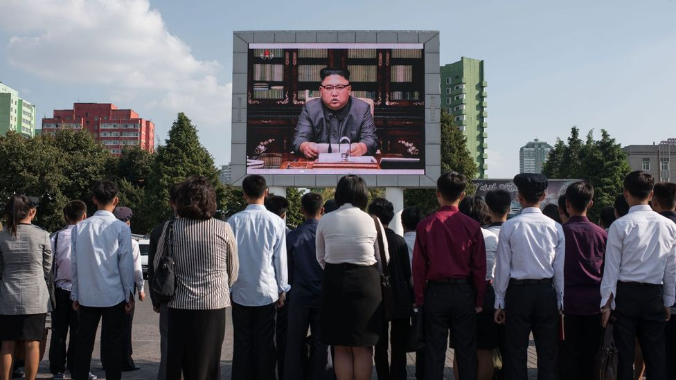 Spectators watching a statment by North Korean leader Kim Jong-Un (Credit: Getty Images)