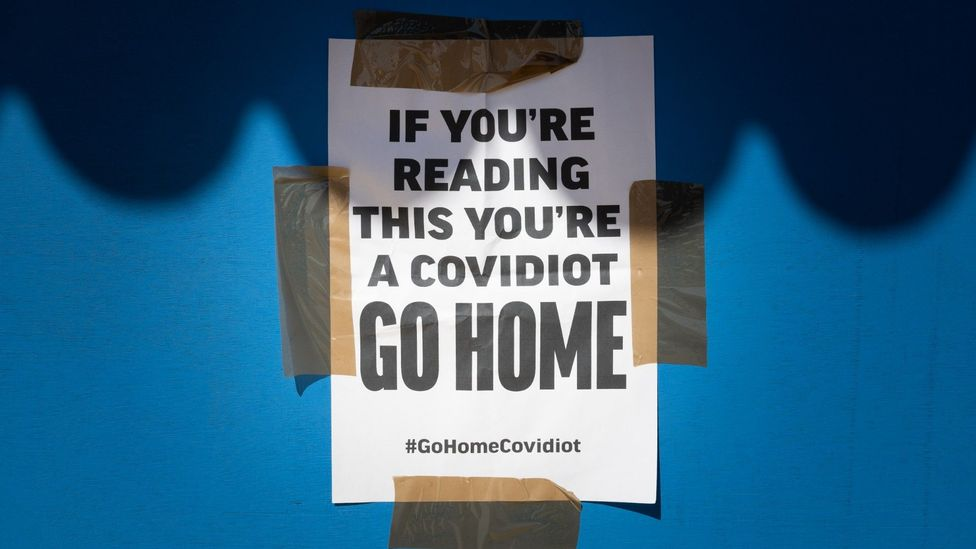 Innovative signs: In the UK, 'covidiots' is being used to described those ignoring social distancing rules