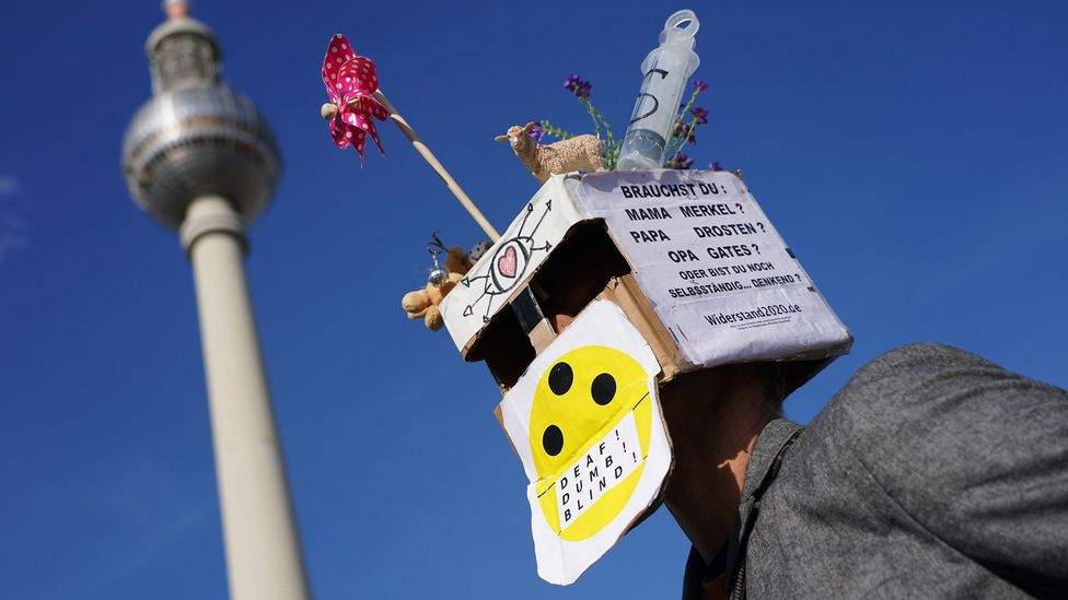 A 5G conspiracy theorist with a cardboard box on his head (Credit: EPA)