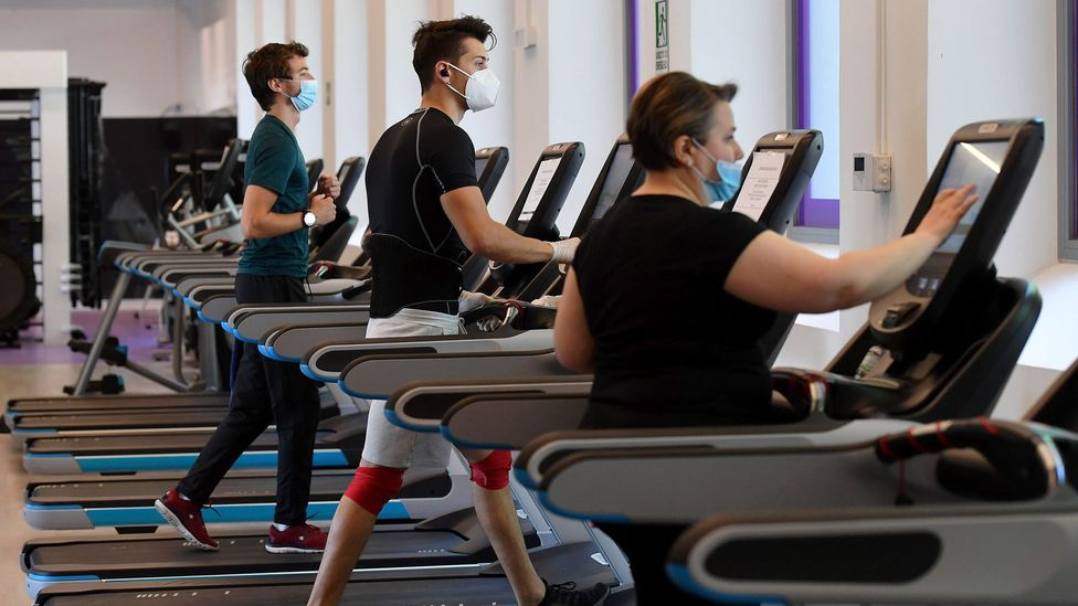 People work out at a gym in Rome in May 2020, carefully spaced apart and wearing masks (Credit: EPA)