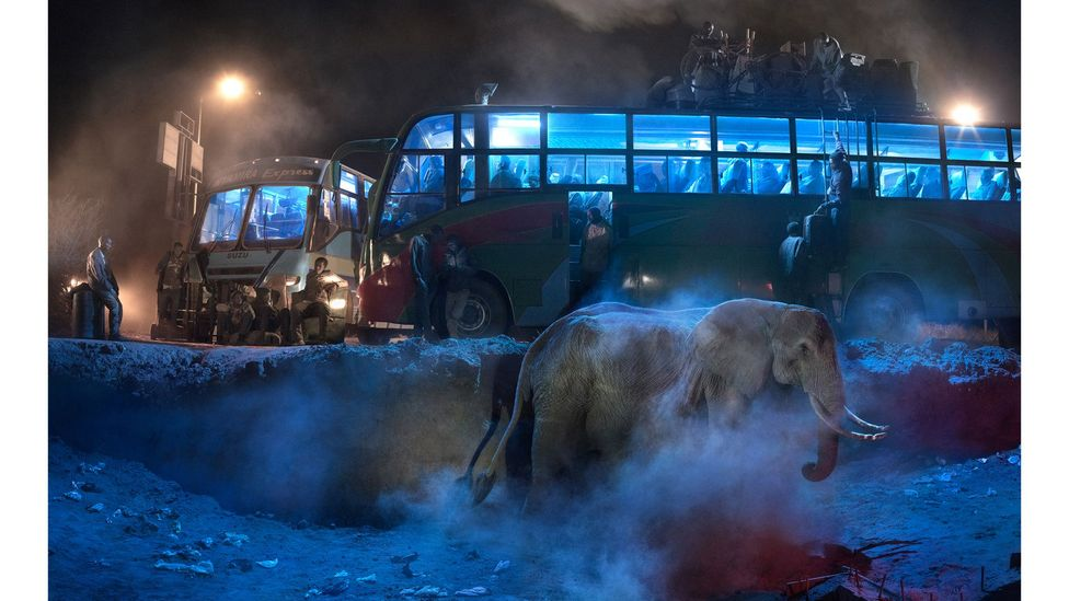 Bus station with elephant in dust by Nick Brandt (Credit: Nick Brandt)