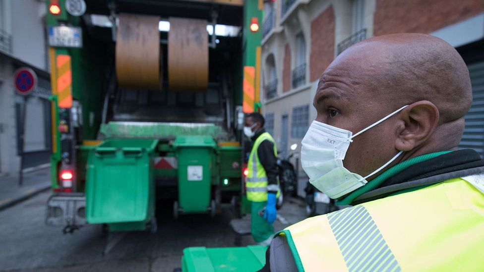 Rubbish collectors in Paris in April. Some experts think the pandemic's intense psychological effects cause people to care less about littering (Credit: Getty Images)