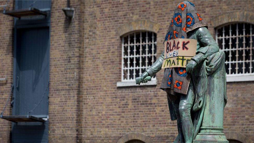 The statue of merchant slave owner Robert Milligan was covered by Black Lives Matter activists in London; it was later removed by the Canal and River Trust (Credit: Getty Images)