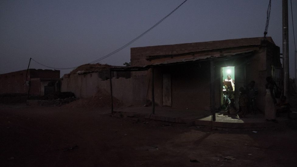 Connecting remote settlements in Africa to the electricity grid can transform the lives of people living there (Credit: Alamy)