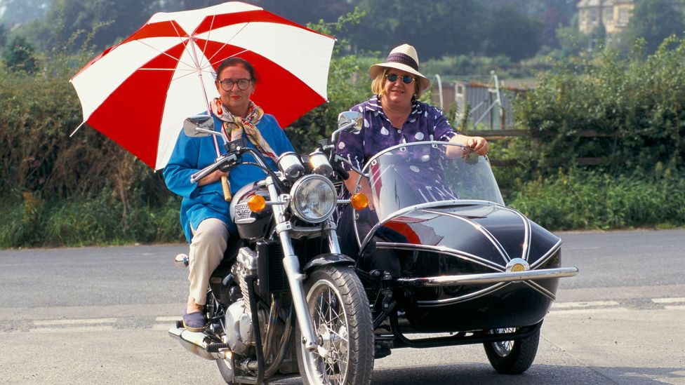 The Two Fat Ladies, aka Clarissa Dickson-Wright and Jennifer Paterson, roared around the UK on a motorbike and sidecar, and like Floyd brought verve to food TV (Credit: Alamy)