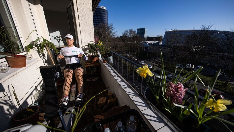 A German rower trains on his balcony in March in Dortmund, Germany (Credit: Getty Images)