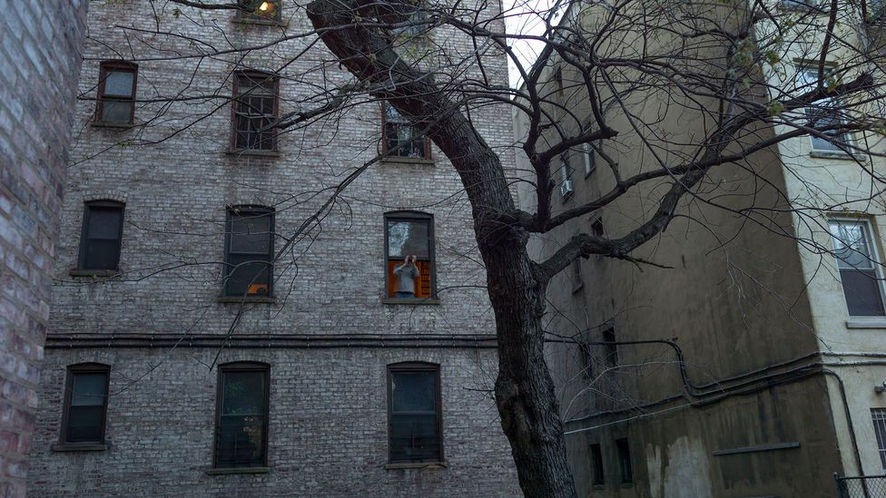 In New York City, it is common to have windows face alleys or other buildings, or lack balconies, gardens and rooftops — which makes lockdown harder (Credit: Getty Images)