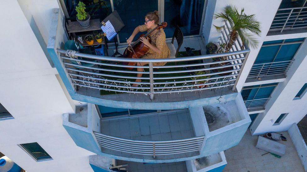 In the absence of gardens in suburbs, city dwellers turn to balconies, like this resident in Panama City. But many flats lack such private outdoor space (Credit: Getty Images)