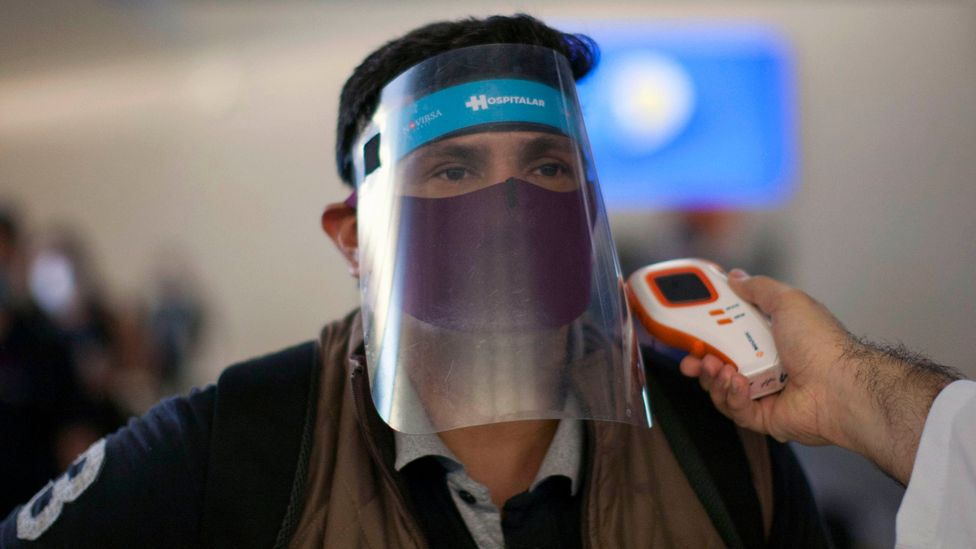 Remote infrared thermometers are already used in airports to detect fevers (Credit: Julio Cesar Aguilar/Getty Images)