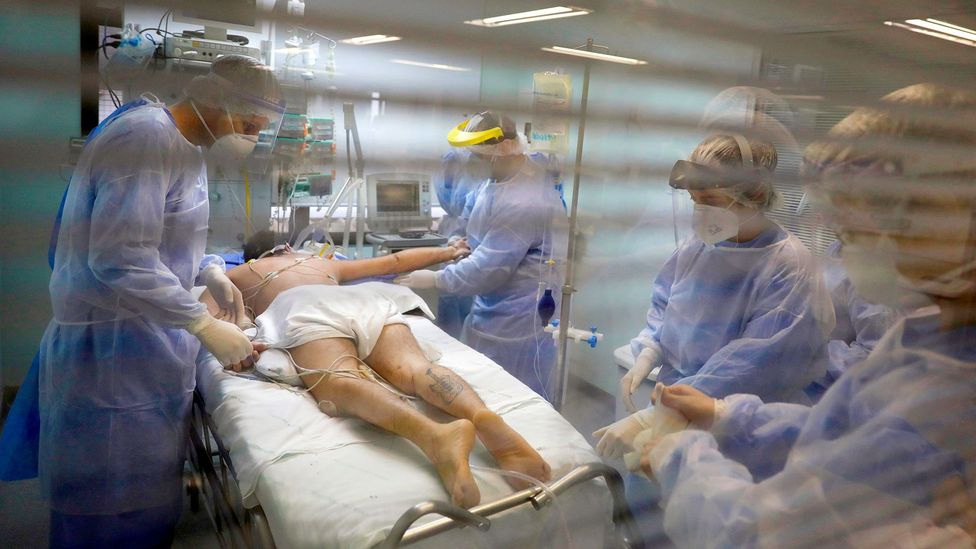Medical workers care for a Covid-19 patient in Porto Alegre, Brazil; some patients recover in two days, while others take months (Credit: Reuters)