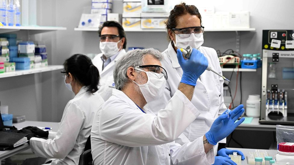 Technicians research Covid-19 at a lab in Buenos Aires, Argentina; more than 300 studies have found neurological abnormalities in Covid-19 patients (Credit: Getty Images)