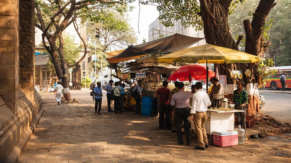 Tapris chai and street vendors can be seen dotted around Indian city streets (credit: Alamy)
