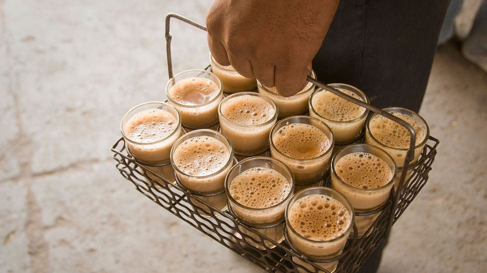 Sharing a milky tea with a hint of spices such as ginger or cardamom with your colleagues is an Indian office ritual (credit: Alamy)