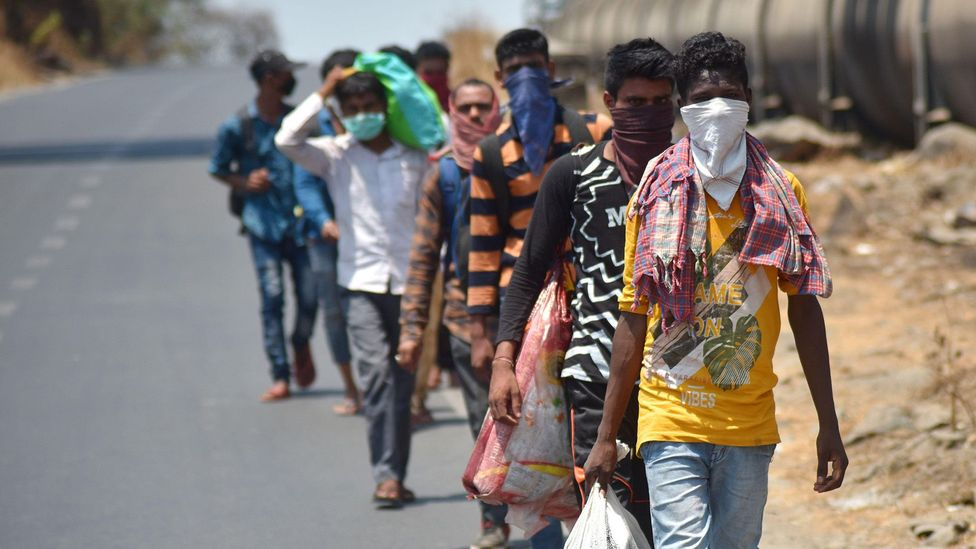 When the lockdown was announced migrant workers left the cities in droves to return to their home towns - many forced to travel by foot (credit: Alamy)