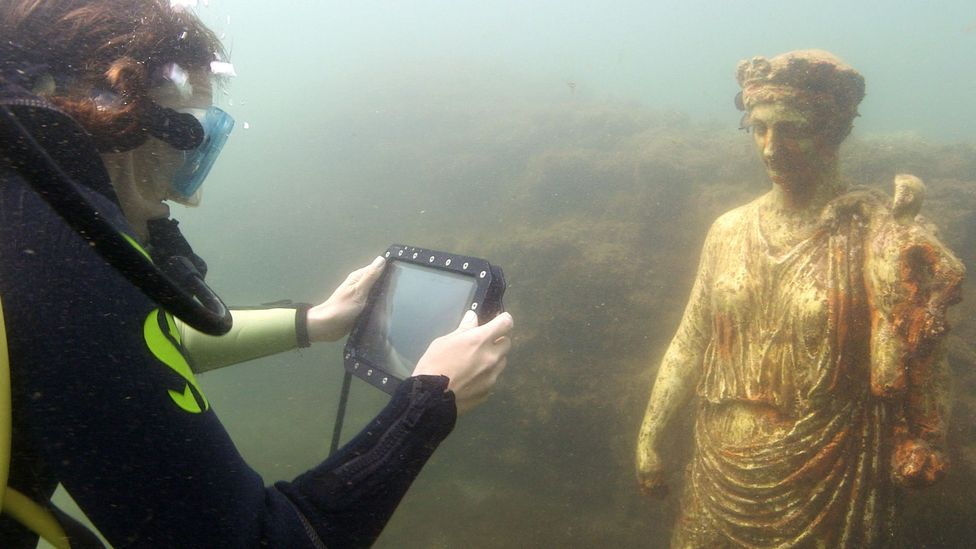 Divers can communicate in real-time with people above the surface using waterproof smart tablets (Credit: Pomona Pictures)