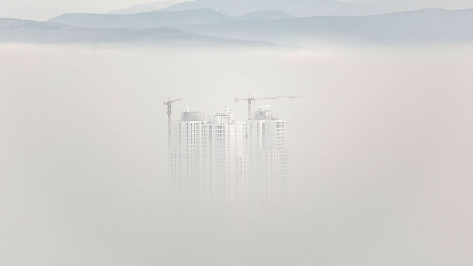 High rise buildings in Skopje rise out of the smog (Credit: Getty Images)
