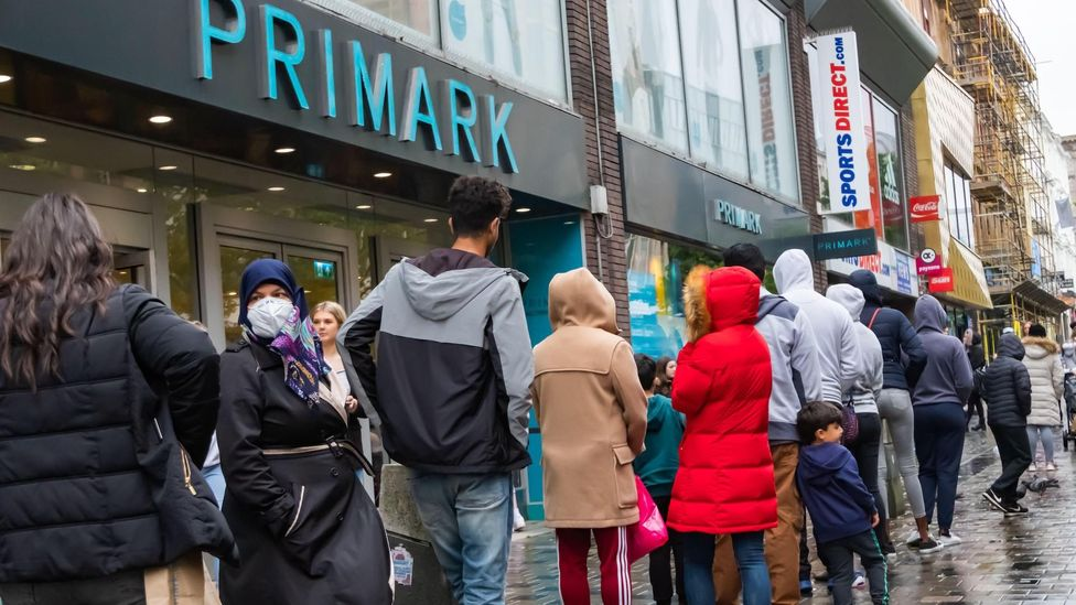 Eager buyers queued at High Street stores on the same day lockdown restrictions were eased, allowing shoppers back in physical stores (Credit: Alamy)