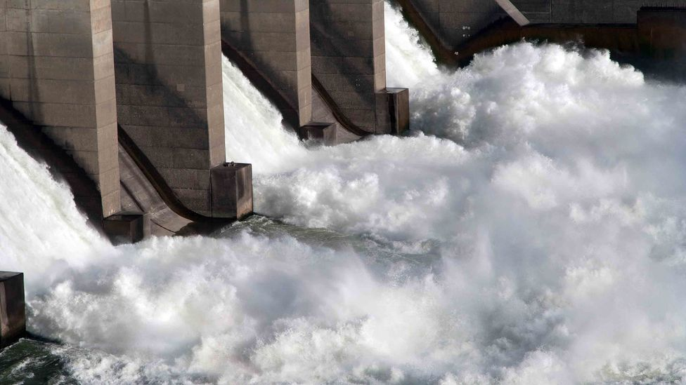 Sudden pressure changes for fish travelling past a traditional dam can kill them, even if they make it past the turbine blades (Credit: Getty Images)