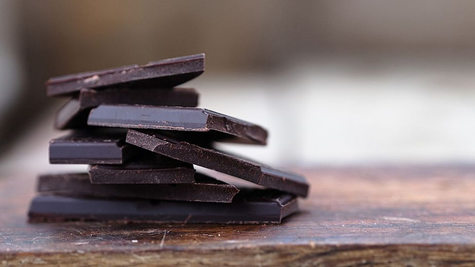 Eating a few squares of rich chocolate regularly might kill the cravings to gorge on a whole bar (Credit: Getty Images)