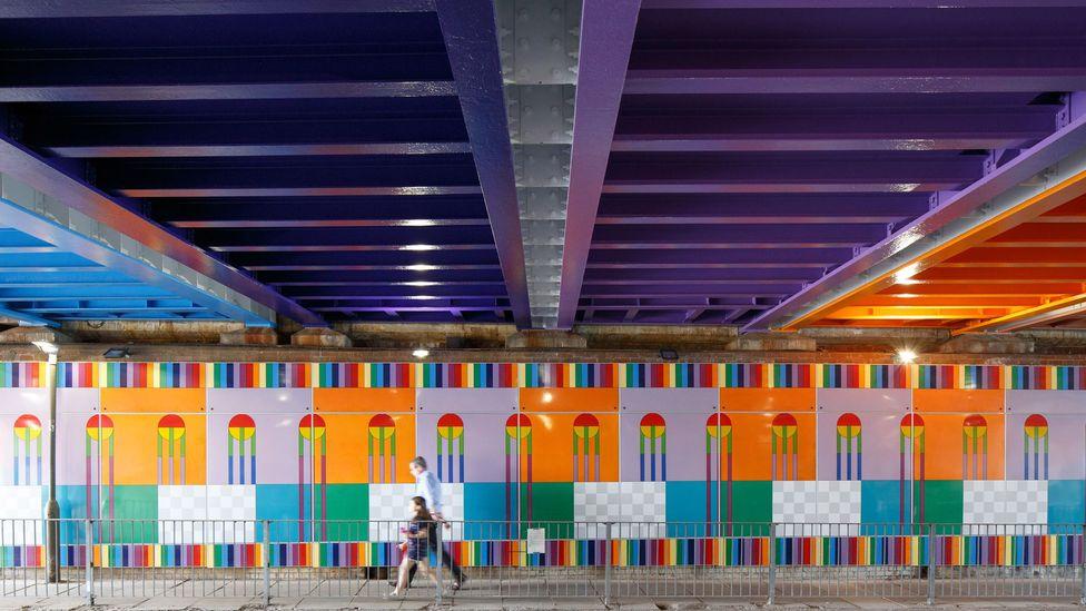 Yinka Ilori's Happy Street permanent installation has transformed a London railway bridge (Credit: Luke O'Donovan)
