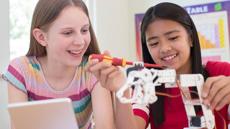 Though society is changing, girls are often conditioned to think that they shouldn't go into maths or science, which can manifest as imposter syndrome in adulthood (Credit: Alamy)