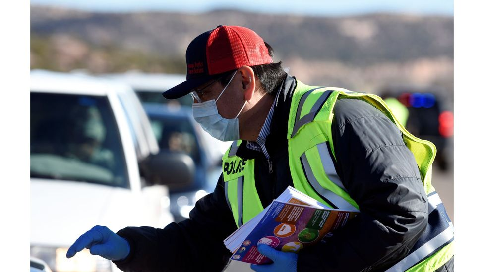 Navajo Nation President Jonathan Nez distributes educational material to drivers on how to prevent the spread of Covid-19 (Credit: Reuters)