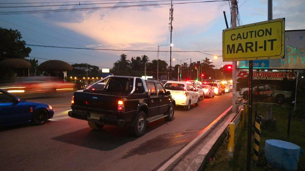 """Road signs designate a stretch of road said to be """"mari-it"""" in Iloilo, Philippines (Credit: Arnel Murga)"""