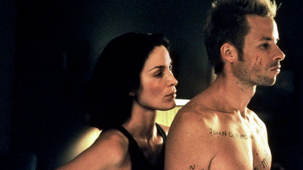 Several of Nolan's films - including Memento, which starred Guy Pearce and Carrie-Anne Moss - depend on wholly cinematic techniques (Credit: Alamy)