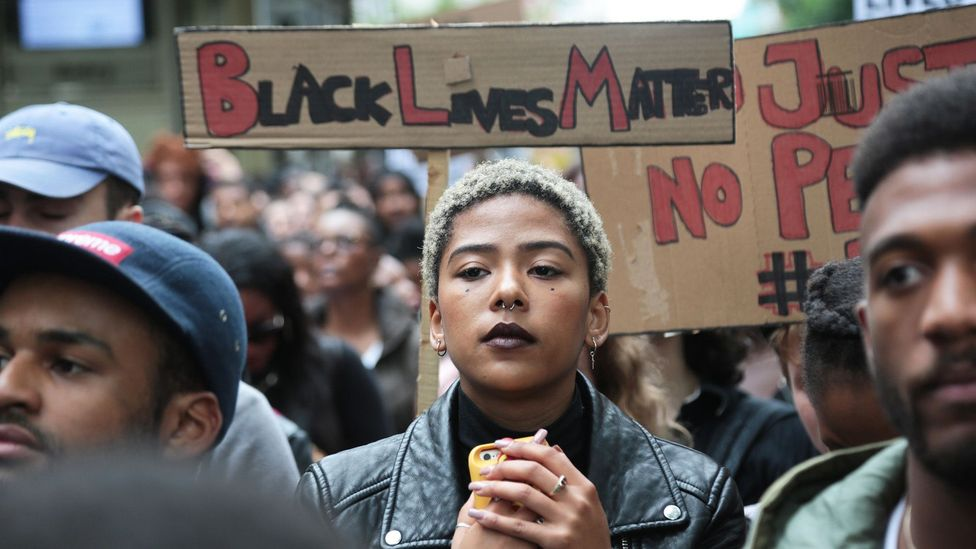 Many talk of the heavy burden of receiving a constant stream of negative messages and images associated with being black (Credit: Alamy)