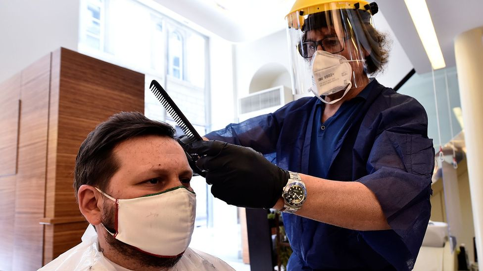 Many businesses that involve close contact with customers, such as hairdressers and barbers, are giving their staff face shields to wear (Credit: Reuters)