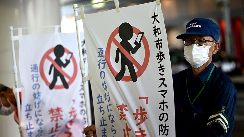 Yamato has become the first Japanese city to ban people using smartphones while walking (credit: Getty Images)