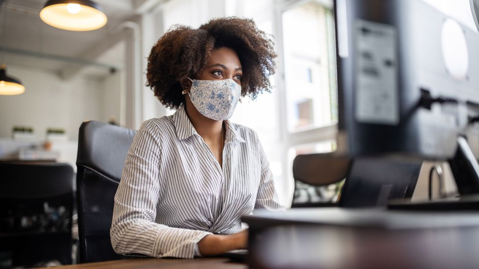 File image of masked worker in an office