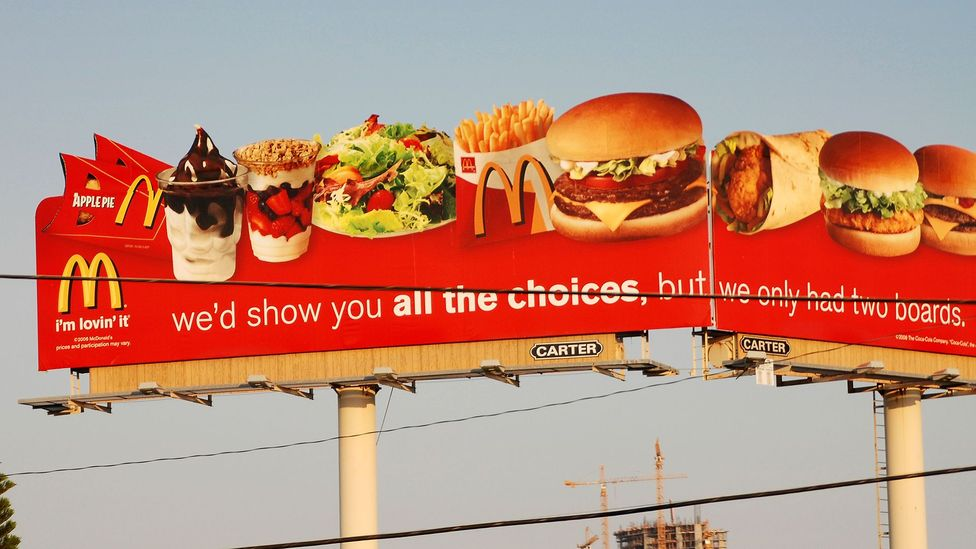Outdoor advertising deepens inequalities in locations where it's more prevalent, experts say - like how fast food makes poorer people less healthy (Credit: Alamy)
