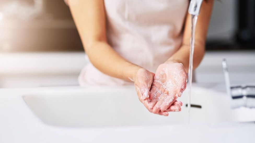 Woman washing hands (Credit: People Images)