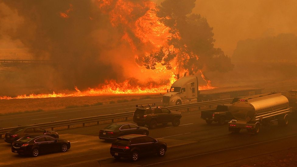 Wildfires in California have quickly spread to threaten homes and vehicles after they were sparked by lightning strikes (Credit: Reuters)