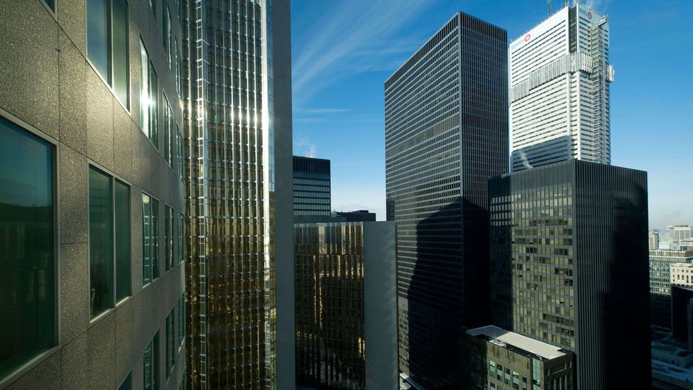 The high-rise buildings on Toronto's Bay Street that usually bustle with thousands of workers now sit mostly empty – meaning few customers for the shops below (Credit: Alamy)