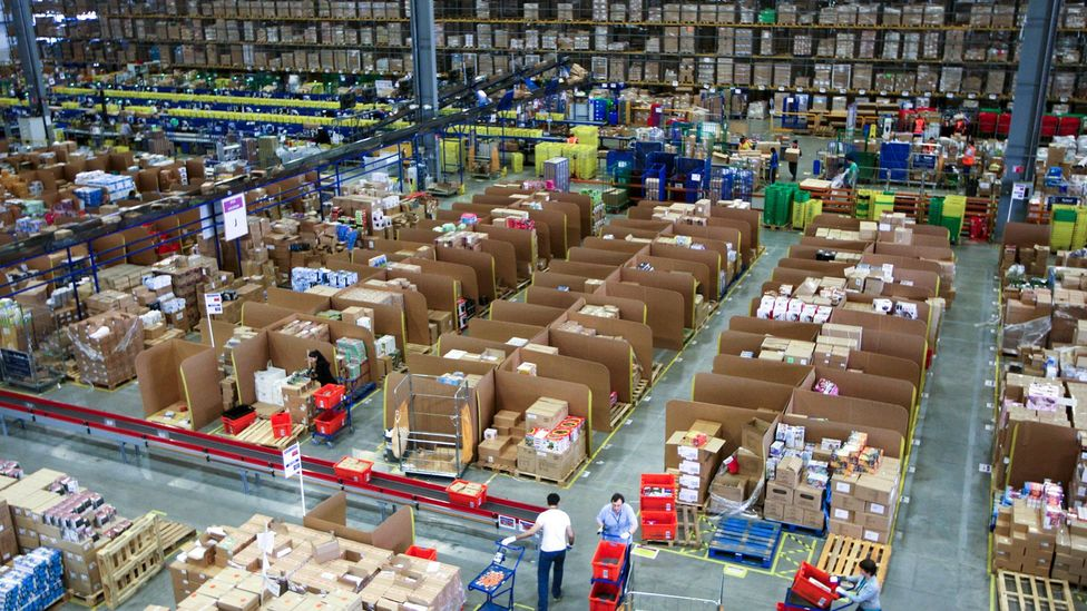 An Amazon warehouse in England. Many Amazon warehouses, like one in Melbourne, Australia, rely on algorithms to help scan items (Credit: Alamy)
