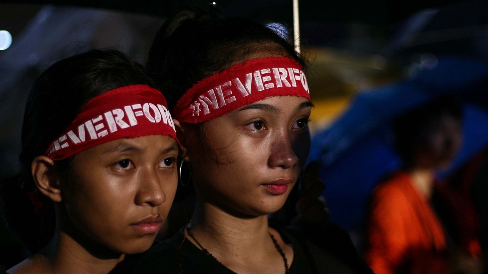 Student protestors in the Phillipines wear headbands saying 'never forget' (Credit: Getty Images)