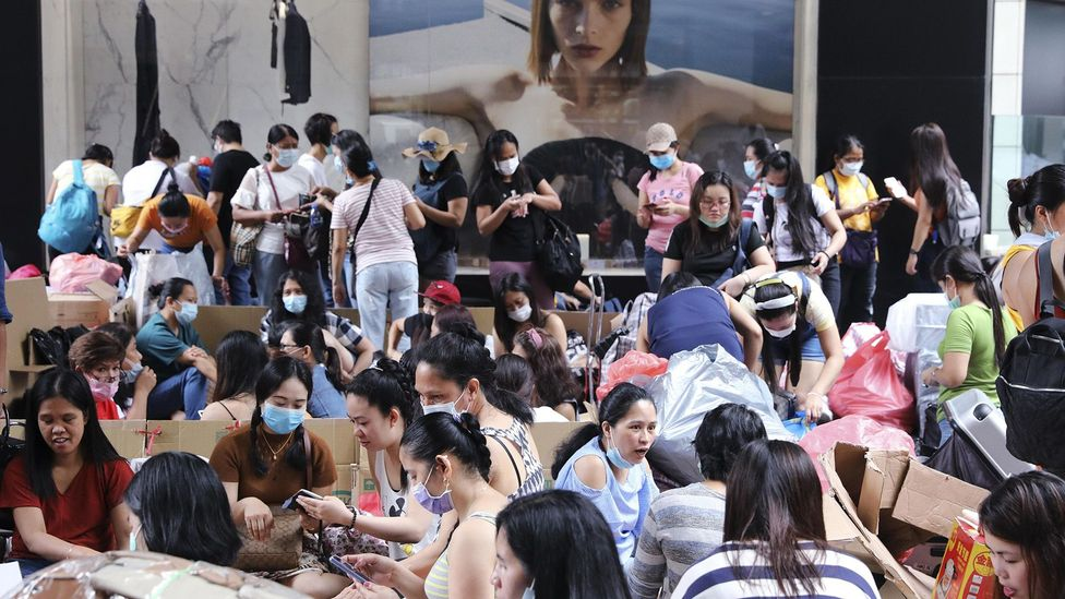 Foreign domestic workers in Hong Kong gather in the Central district on their weekly day off (Credit: Alamy)