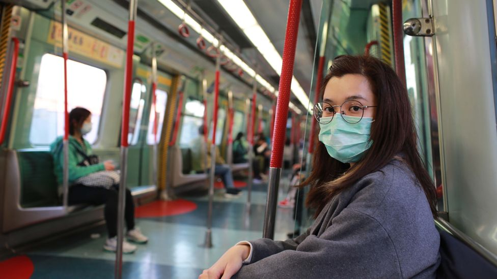 A woman rides a sparsely occupied carriage in Hong Kong (Credit: Getty Images)