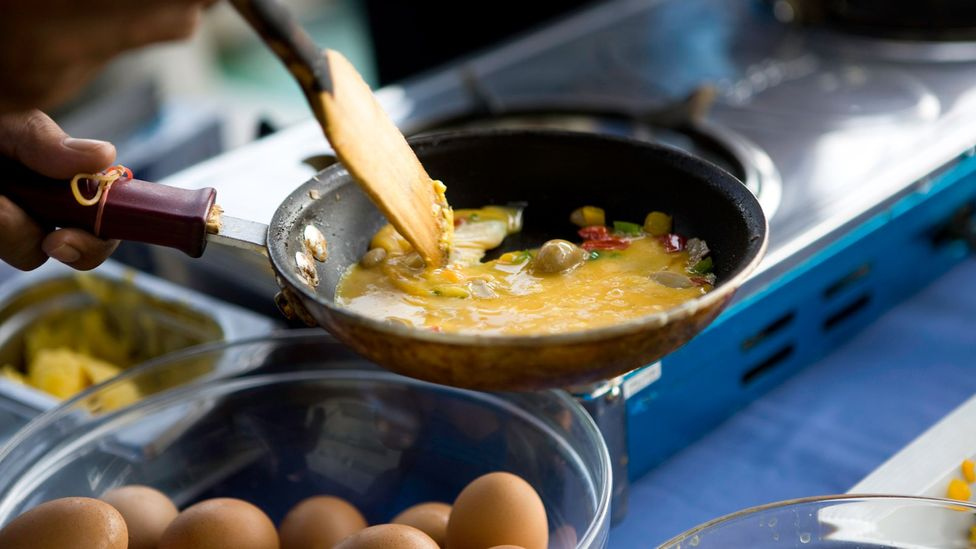 Frying an omelette or making breakfast can release a surprising amount of tiny pollutant particles known as PM2.5s (Credit: Getty Images)