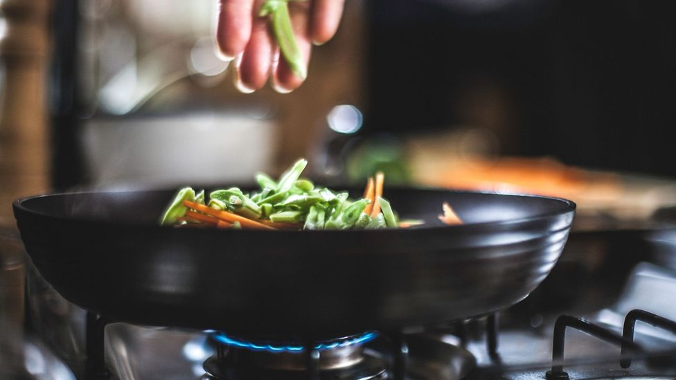 Experts recommend using an extractor fan when cooking due to the spike in air pollution the activity causes (Credit: Getty Images)
